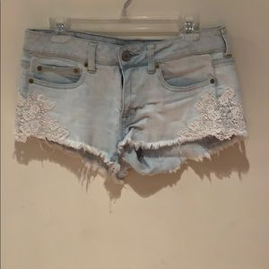 Denim shorts with lace detail